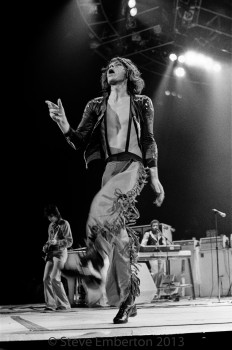 Mick Jagger strutting across the stage